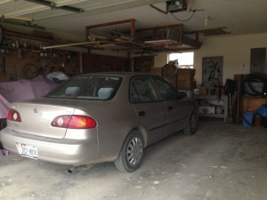 Sam's car parked in the barn formerly known as a garage